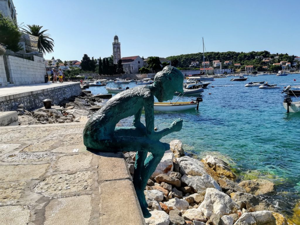 Hvar harbour, bronce statue, sculpture, beautiful, Hvar old town, seafront, summer, europe, Croatia,